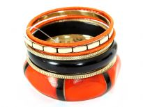 Beautiful orange with black & gold tone 7 piece bangles set has hexagon shape wide cuff worn out look orange bangle, one thick black resin bangle, boxy pattern gold bangle, 2 orange fabric bangles & 2 gold bangles.