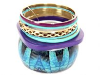 Beautiful & attractive seven piece bangles set has one painted wide cuff bangle, one purple square bangle, 2 turquoise fabric bangles, one gold etched design & 2 resin bangles. Can light up any outfit it is worn with.