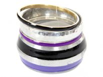 Purple & black striped silver wide cuff bangle in this four piece bangles set which also has silver wide bangle & 2 thin bangles in purple/black colors. Lightweight & durable costume jewelery set.