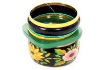 Floral print wide cuff bangle with six solid bangles makes this colorful seven pieces bangles set. Two yellow colored resin bangles, two green thread bangles, one medium thickness black bangle & one square shape green resin bangle.
