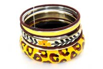 This attractive seven pieces bangles set includes one animal print wooden bangle, one floral hand painted resin bangle, three thread covered thin bangles, one yellow resin bangle & one gold colored metal bangle. Imported.