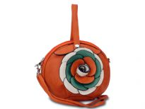 Round clutch bag has an accentuating floral detail, a top zipper closure and a detachable single strap. Made of fuax leather.