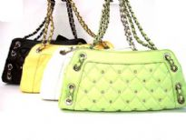 Designer Inspired Shoulder Bag with checkered pattern and studded details has a zipper closure and a double handle. Bag has whole details. Made of faux leather.