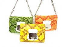 Designer inspired shoulder bag has a magnetic closure, a chan strap and an animal print pattern. Made of faux leather.