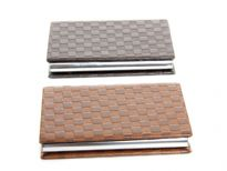 Checker embossed business card holder. Magnetic snap closing.