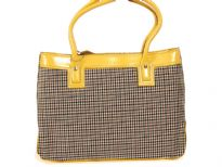 PVC Fashion Handbag has a plaid pattern and yellow trim. Top zipper closure and double handle.