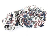 Ivory colored 100% cotton scarf with multicolored floral print on it. Imported. Hand wash.