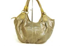 Designer Inspired Hobo Shoulder Bag with metallic texture, zipper closure and a double handle. Made of PU (polyurethane).