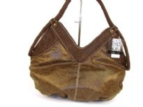 Designer Inspired Hobo Shoulder bag with a double handle and V-shapped zipper closure. Made of PU (polyurethane).