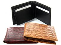 Carry your money in style. This is a Crocodile embossed genuine cow leather bifold mens wallet. The outside shell is genuine cow-hide leather and the inside is faux leather. As this is genuine leather, please be aware that there will be some small creases and nicks in the leather but the wallet are all brand new.