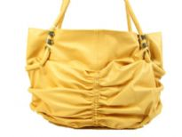 Spacious fashion shoulder bag has a ruched front, top zipper closure and a double handle. Made of PU.