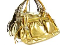 Designer Inspired Metallic Shoulder Bag with top zipper closure, double shoulder straps, two side open pockets with drawstring closure & two front zipper pockets. Chain accents in the front. Made of PU (polyurethane).