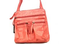 Fashion bag has multiple exterior pockets with zipper closure. Single strap. Made of PVC.