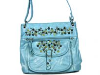 Studded shoulder bag has a top zipper closure, outside pockets and an adjustable single strap. Made of faux leather.
