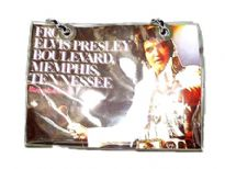Elvis Presely Tote Handbag. With a magnetic closure made with vinyl material and has double handle.