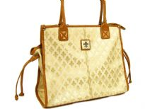 Fleur De Liz Licensed Jacquard Handbag. This spacious bag in jacquard material has leather trim bordering the bag & also hanging tussles on the sides. Top zipper closure.