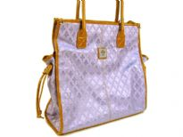 Fleur De Liz Licensed Jacquard Handbag. Double Handle & top zipper closure in leather. Two side pockets outside the bag with hanging leather strands & outside zipper pocket. Leather trim borders the bag.