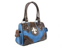 Fleur De Liz PVC double handle bag. Top zipper closing. Two side pockets and back zipper pocket.