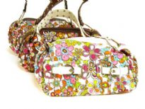 Floral Print Fabric handbag with PVC buckled belts in front & studded strap