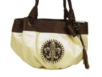 Fleur De Liz Licensed PVC Handbag with braided double handle, hanging tussle in the front, broad leather trim on the top in contrast color. Fleur De Liz logo in the center with studded rhinestones.
