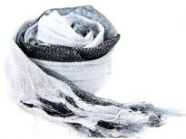 This lightweight 50% viscose & 50% polyester scarf in black, grey & white shades with silver stripes running through it can be used all year around to give an edge to your outfit. Long knotted tussels on its edges. Imported.