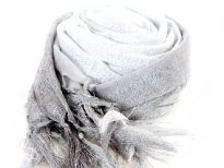 This lightweight 50% viscose & 50% polyester scarf in grey, silver & white shades with silver stripes running through it can be used all year around to give an edge to your outfit. Long knotted tussels on its edges. Imported.