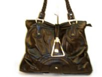 Designer Inspired Shoulder Bag has a top zipper closure and a double braided handle. Bag has a sunrise detail in the bottom. Bag is made of PU (polyurethane).