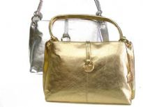 Shiny Genuine Leather Handbag with Shoulder Handle & clasp over the zipper closure.