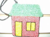 Multi color beaded coin purse in the shape of hut. Top zipper closure with wrist strap also. Imported.
