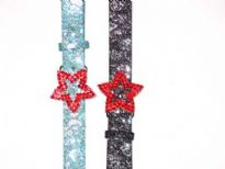 Ladies Belts/Sold Per dozen. Belt has a shinny texture and a star buckle.