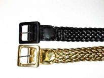 Ladies Belt has a braided pattern and a metallic texture.
