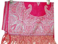 Fuchsia colored 100% Pure Wool Jamawar Shawl with paisley pattern in shades of green knitted into it. Fringes on the edges of the shawl. Imported.