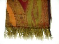 Multi Colored 100% Pure Wool Jamawar Shawl with shades of green, red & orange. Threads like fringes on the edges of the shawl. Imported.
