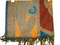Teal colored 100% pure wool Jamawar shawl with shades of red & orange also. Artistically patterned with paisley shapes. Fringes on the edges. Imported.