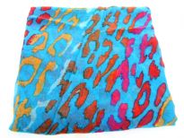 Semi-sheer turquoise blue polyester scarf with multi colored abstract print. Big size of the scarf makes it possible to be used as a shawl, wrap or scarf around the neck. Imported. Hand wash.