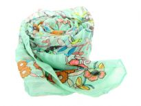 A garden of multi colored floral print blooms over this finely made 100% polyester scarf in light green which is lightweight to use. It can be used all year around with any kind of outfit. Imported. Hand wash.