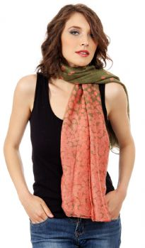 A duo of complementary hues dramatically shade this lightweight polyester scarf patterned with always-classic polka dots. Dense polka dots on one end of the scarf gives an edge to this essential scarf.