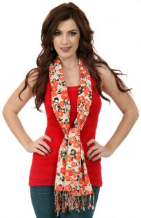 Orange & black colored flowers bloom over this beige yarn dyed 100% viscose scarf. Twisted fringes on the ends. Imported.