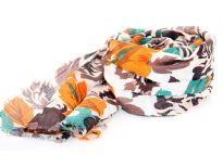 Orange & brown colored flowers bloom over this off-white cotton scarf which is lightweight & soft. Imported. Hand wash.
