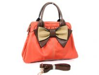 Bow accent dual compartment fashion handbag. Top zipper closing.  Adjustable shoulder strap included. Back zipper pocket.
