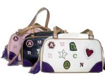 Designer Inspired Handbag has embellished letters, top zipper closure, and a double handle. Made of faux leather.