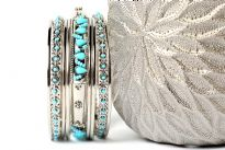 This sparkling silver metal 9 pieces set can be matched with any kind of outfit during day or at night. Set includes 6 plain thin bangles, 2 similar round beads bangles & one wide metal pattern bangle with turquoise beads.