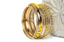 This gold colored metal 9 pieces set can be matched with any kind of outfit during day or at night. Set includes 6 plain thin bangles, 2 similar round beads bangles & one wide metal pattern bangle with yellow beads.
