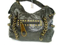 Sand wash fashion handbag with zipper accent in the front & also small rings like accent all over it.