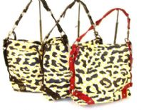 Designer Inspired Shoulder Bag has a squared design featuring a top zipper closure and a single strap. Bag has an animal print patter design and a single color belted frame. Made of faux leather.