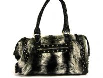 Faux Fur PU Fashion Handbag with Patent leather patchwork with studs over them. Double shoulder handle & zipper closure.