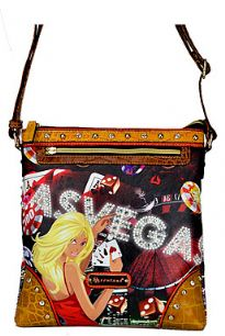 Las Vegas Print crossbody bag with studs at different places. Top zipper closure with adjustable shoulder strap and outside zipper pocket.