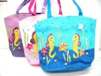 Hand crafted straw bag embroidered with a beach theme and sea horses. Double shoulder straps.