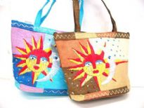Multi colored crafted straw bag embellished with a moon and a sun. Double shoulder straps. Zipper closure.