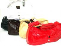 PVC Handbag has a top zipper closure and a single strap. Small diamond details along center.